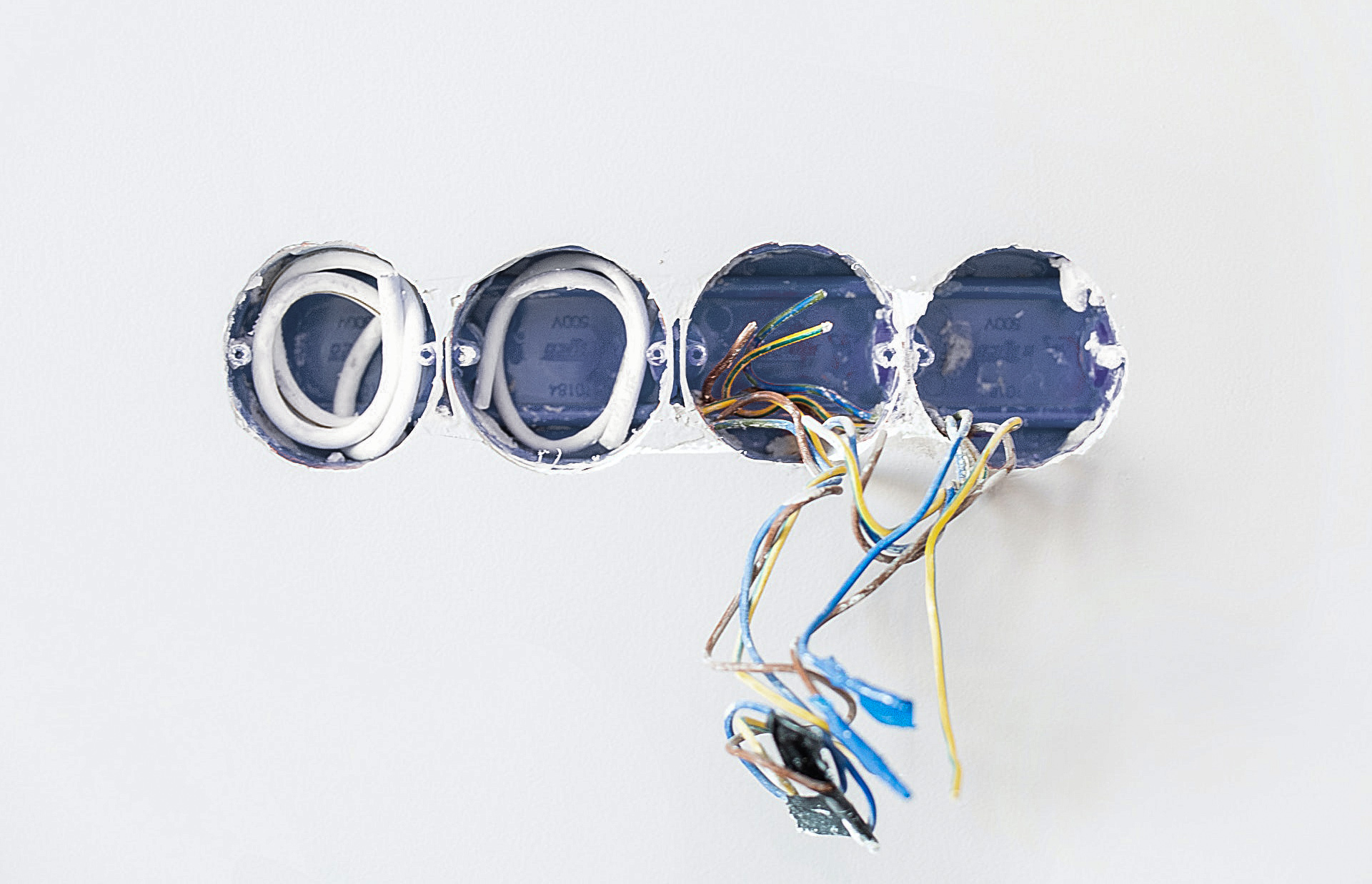Four holes made by an electrician